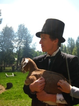 You can't always turn your back on modernity (represented symbolically by this grasping modern hand of a visitor). Keep a firm hold on your historical goat! (A metaphor for something deep, I am sure.) Photograph taken by Lauren Markewicz on 1885 Street at Fort Edmonton Park, 2012.