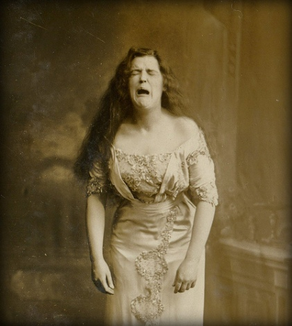 A portrait of a woman from around the turn of the century. This photo may have been taken mid-sneeze. i hope i am immortalized in this manner